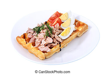 Belgian waffle with ham, boiled egg and tomato on white -...