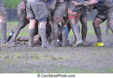 Rugby match. - Detail muddy boots in a rugby match.