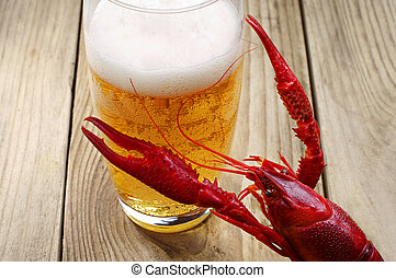 Crawfish and a glass of beer - Red boiled crawfish and a...