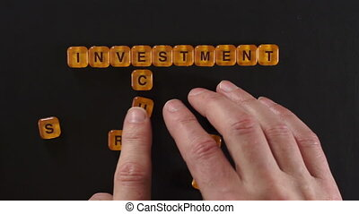Letters Spell Investment Security - A close up shot of a man...