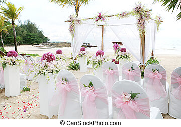 Floral arrangement at a wedding ceremony on the beach