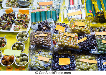 Market counter with olives and olive products - Market...