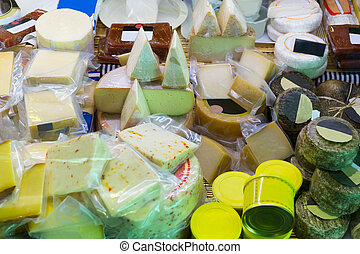 Assortment of cheese at market stand - Assortment of fresh...