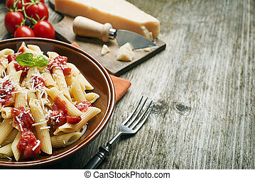 Pasta - Plate of penne pasta with tomato sauce and parmesan...