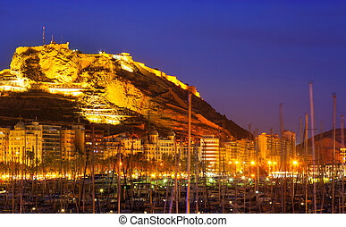 port with yachts against Castle in night. Alicante, Spain