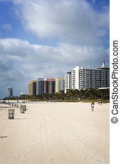 Walking along South Beach - People walk and exercise along...