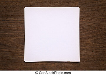 Blank paper note on wood background