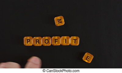 Letter Blocks Spelling More Profit - A close up shot of a...