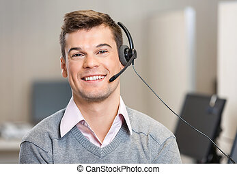 Customer Service Representative Wearing Headset While...