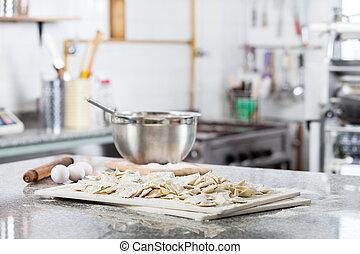 Unprepared Ravioli Pasta At Countertop In Commercial Kitchen...