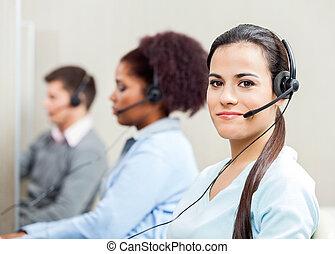 Portrait At Confident Female Customer Service Representative...