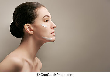 healthy face - beauty woman on the grey background