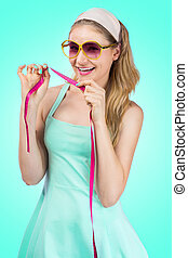 Fit retro woman with tape measure