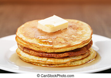 Classic pancakes with butter and syrup