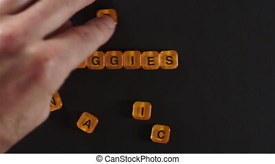 Letter Blocks Spell Organic Veggies - A close up shot of a...