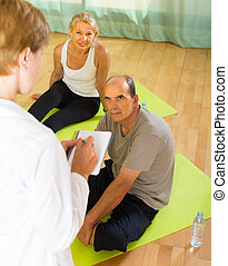 Medical staff with senior people at gym - Medical staff...