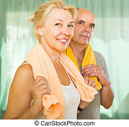 Elderly couple after training - Positive elderly couple...
