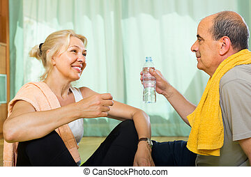 Elderly couple after training - Senior mature spouses with...