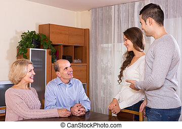 Girl introducing boyfriend to parents - Adult smiling...