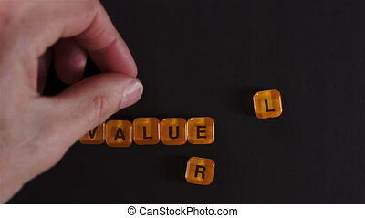 Letter Blocks Spelling Real Value - A close up shot of a man...