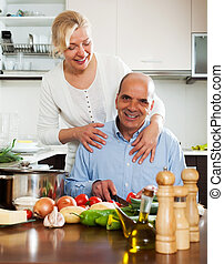 happy family cooking Spaniard tomatoes at home kitchen