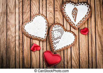 Handmade gingerbread heart on wooden background.  Valentines Day love symbol.