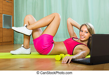 Girl working out with notebook in gym - Positive smiling...