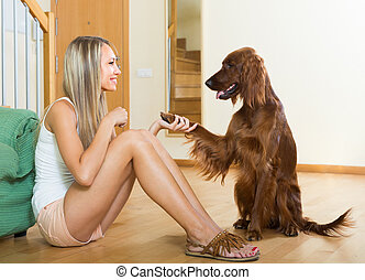 Adult girl with red Irish setter - Happy smiling adult girl...