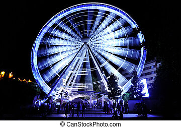 ferris wheel at amusement park at night - ferris wheel in...
