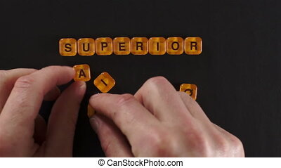 Letters Spelling Superior Quality - A close up shot of a man...