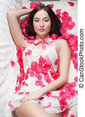 gorgeous girl lying in rose petals. - gorgeous sexy girl...
