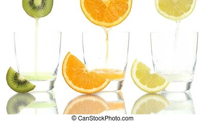 Juice orange lemon kiwi poured into glass