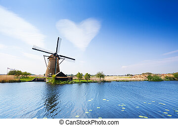 Landscape with water pumping windmill - Water pumping mill...