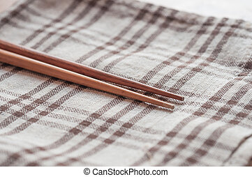 Wooden chopsticks on table cloth