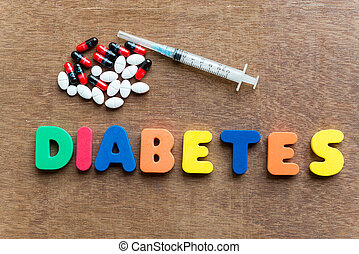 diabetes colorful word in the wooden background