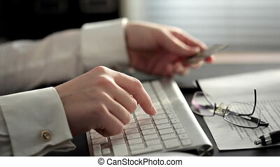 Online Purchase - Shot of a business woman using credit card...