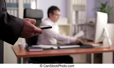 Businessman Sending Sms - Businessman sending SMS while in...