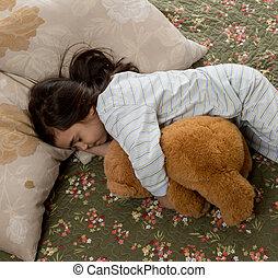 girl sleeping with teddy bear - little young girl sleeping...