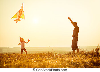 Dad with his daughter let a kite - Dad with his little...
