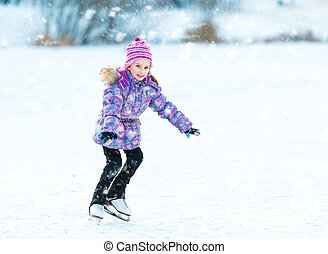 little girl skating - cheerful little girl skating in winter