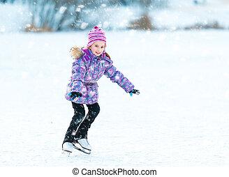 little girl skating - cheerful little girl skating in winter