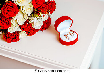 wedding rings and roses bouquet