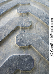 Closeup of run-down tractor tire with pattern - Run down...