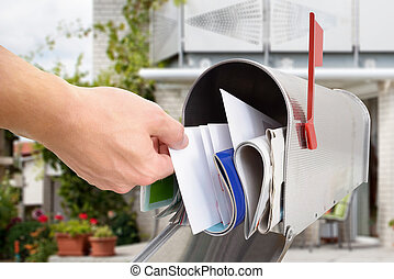Man Taking Letter From Mailbox - Close-up Of Man's Hand...