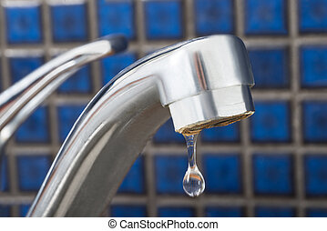 Water Drop Dripping From Tap - Close-up Of Leakage Tap With...