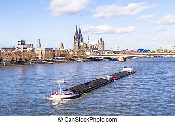 Cologne skyline with dome and bridge under blue sky