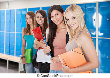 Young Female Students In Changing Room - Group Of Happy...