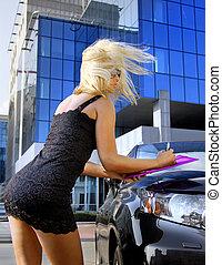 blonde businesswoman writing something - beautiful blonde...