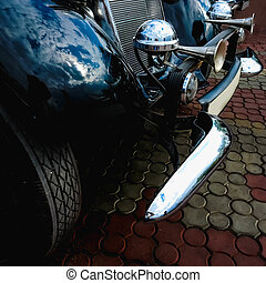 Old retro or vintage car front side with beep horn