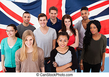 English Classes - Happy Group Of Diverse Students Standing...
